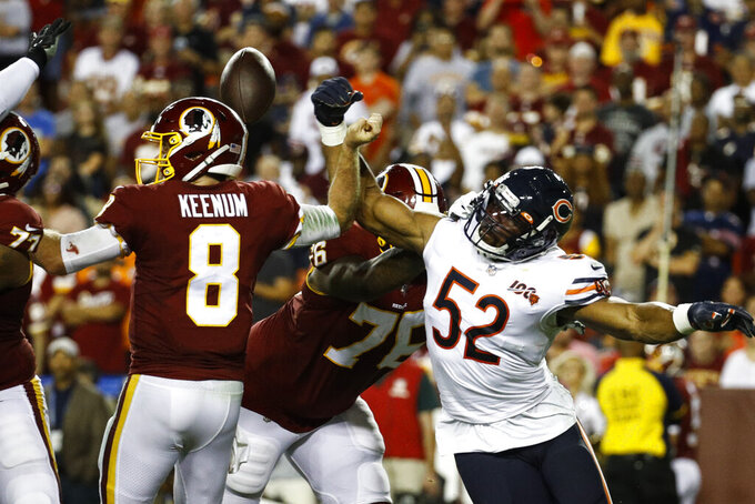 Washington Redskins quarterback Case Keenum (8) loses the ball as he is hit by Chicago Bears outside linebacker Khalil Mack (52) during the first half of an NFL football game Monday, Sept. 23, 2019, in Landover, Md. (AP Photo/Patrick Semansky)