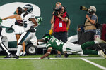 Philadelphia Eagles' Boston Scott, left, breaks away from New York Jets' J.T. Hassell during the first half of an NFL preseason football game Friday, Aug. 27, 2021, in East Rutherford, N.J. Scott scored a touchdown on the play. (AP Photo/John Minchillo)