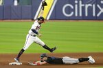 Atlanta Braves' Dansby Swanson makes forces out Miami Marlins' Corey Dickerson during the eighth inning in Game 2 of a baseball National League Division Series Wednesday, Oct. 7, 2020, in Houston. (AP Photo/Michael Wyke)