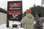 A snowboarder takes a photo of message on a sign in Stowe, Vt, on Friday, Nov. 22, 2019, that honors snowboard pioneer Jake Burton Carpenter who died on Wednesday. Employees of Burton Snowboards, which he founded, gathered at Stowe Mountain Resort on opening day Friday in honor of Carpenter. (AP Photo/Lisa Rathke)