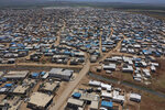 FILE - This April 19, 2020 file photo shows a large refugee camp on the Syrian side of the border with Turkey, near the town of Atma, in Idlib province, Syria. The head of the U.N. food agency warned of starvation and another wave of mass migration from Syria to Europe unless donors countries step up financial assistance to the war-ravaged country. (AP Photo/Ghaith Alsayed, File)
