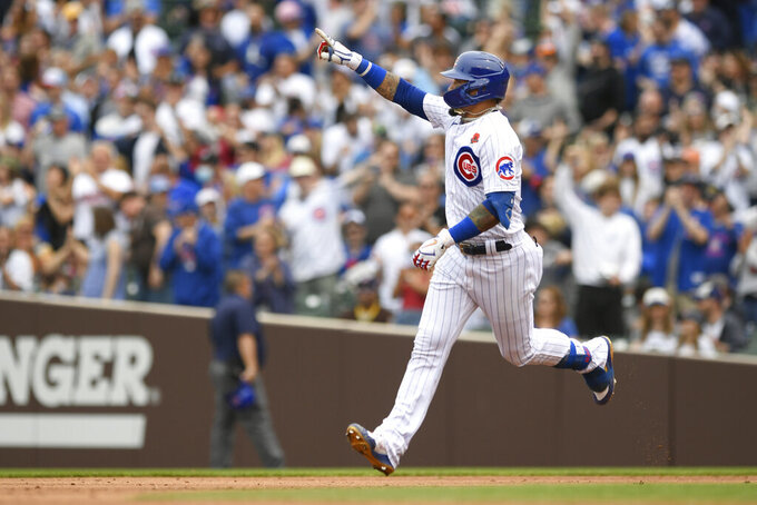 Chicago Cubs' Javier Baez celebrates while rounding the bases after hitting a two-run home run during the third inning of a baseball game against the San Diego Padres on Monday, May 31, 2021, in Chicago. (AP Photo/Paul Beaty)