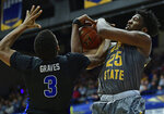 Kent State forward Philip Whittington, right, and Buffalo guard Jayvon Graves reach for a rebound during the second half of an NCAA college basketball game, Friday, Jan. 25, 2019, in Kent, Ohio. (AP Photo/David Dermer)