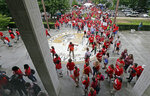 Participants make their way into the Legislative Building during a teachers rally at the General Assembly in Raleigh, N.C., Wednesday, May 16, 2018. Thousands of teachers rallied the state capital seeking a political showdown over wages and funding for public school classrooms. (AP Photo/Gerry Broome)