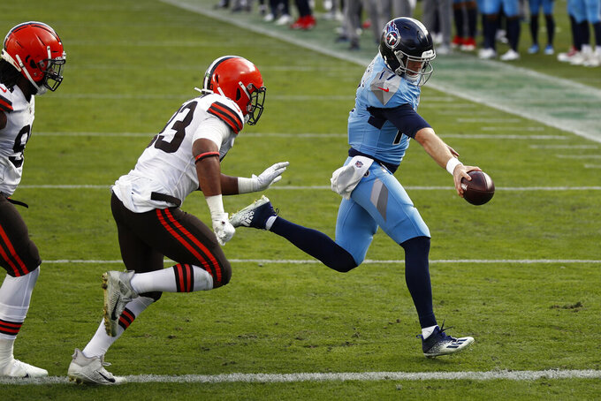 Tennessee Titans quarterback Ryan Tannehill (17) scores a 2-point conversion against the Cleveland Browns in the second half of an NFL football game Sunday, Dec. 6, 2020, in Nashville, Tenn. (AP Photo/Wade Payne)