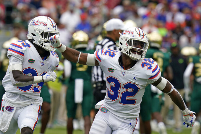 Florida safety Mordecai McDaniel (32) celebrates after stopping a run by South Florida during the first half of an NCAA college football game Saturday, Sept. 11, 2021, in Tampa, Fla. (AP Photo/Chris O'Meara)
