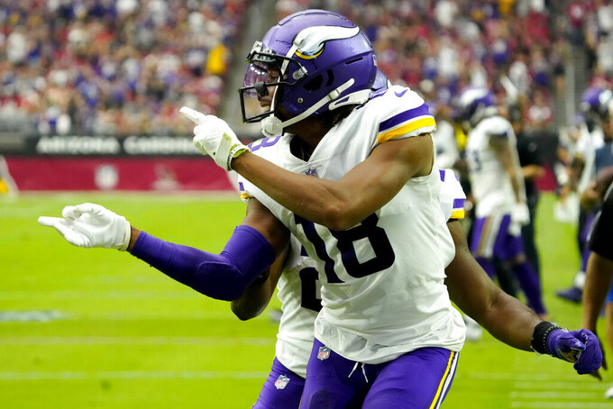 Minnesota Vikings wide receiver Justin Jefferson (18) celebrates his touchdown against the Arizona Cardinals during the first half of an NFL football game, Sunday, Sept. 19, 2021, in Glendale, Ariz. (AP Photo/Rick Scuteri)