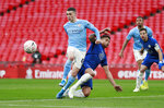 Manchester City's Phil Foden, left, challenges for the ball with Chelsea's Thiago Silva during the English FA Cup semifinal soccer match between Chelsea and Manchester City at Wembley Stadium in London, England, Saturday, April 17, 2021. (AP Photo/Ian Walton, Pool)