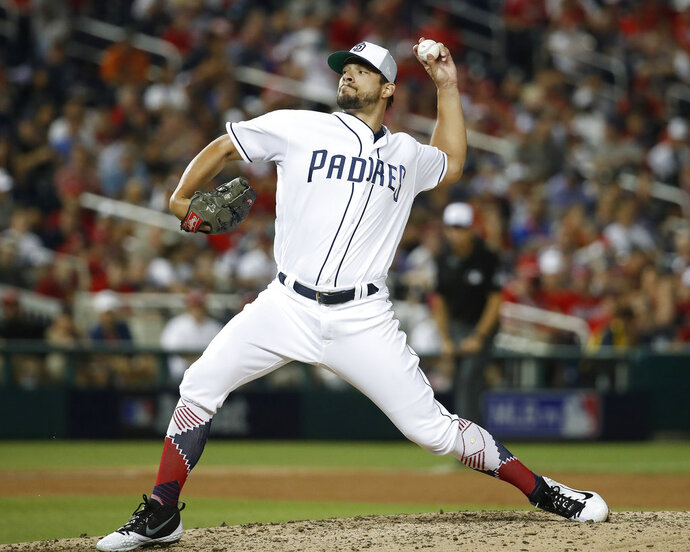 San Diego Padres pitcher Brad Hand (52) throws in the eighth inning during the Major League Baseball All-star Game, Tuesday, July 17, 2018 in Washington. (AP Photo/Alex Brandon)