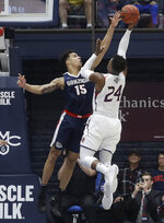 Saint Mary's forward Malik Fitts (24) shoots against Gonzaga forward Brandon Clarke (15) during the first half of an NCAA college basketball game in Moraga, Calif., Saturday, March 2, 2019. (AP Photo/Jeff Chiu)
