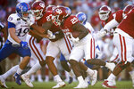 Oklahoma running back Rhamondre Stevenson (29) carries the ball during an NCAA college football game against Kansas in Norman, Okla., Saturday, Nov. 7, 2020. (Ian Maule/Tulsa World via AP)