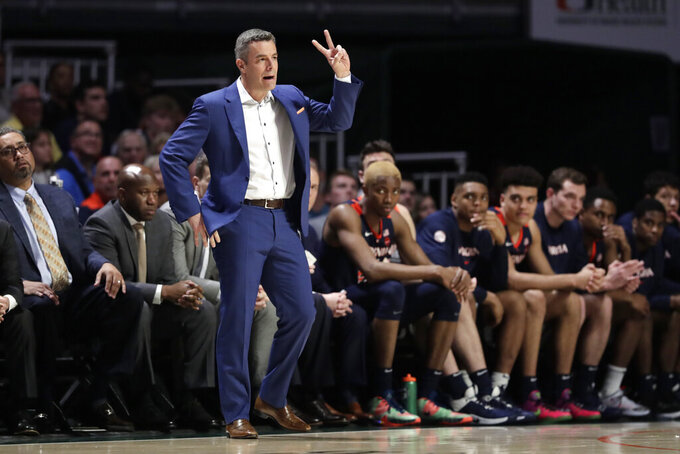 FILE - Virginia head coach Tony Bennett watches during the first half of an NCAA college basketball game against Miami, Wednesday, March 4, 2020, in Coral Gables, Fla.   (AP Photo/Lynne Sladky)