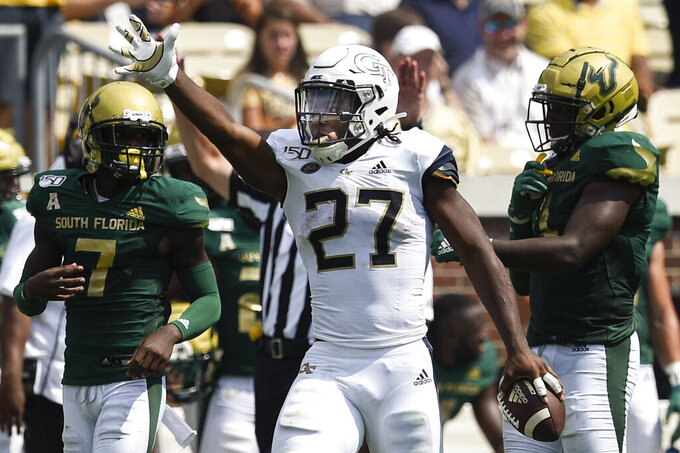 Georgia Tech running back Jordan Mason (27) celebrates his run for a first down against South Florida during the first half of an NCAA college football game Saturday, Sept. 7, 2019, in Atlanta. (AP Photo/Jon Barash)