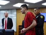 Washoe County District Attorney Christopher Hicks, left, looks on as Wilbur Martinez-Guzman, from El Salvador, appears in Washoe District Court in Reno, Nev., on Monday, May 20, 2019. Martinez-Guzman faces charges for the murders of four people in Northern Nevada. (Andy Barron/The Reno Gazette-Journal via AP)