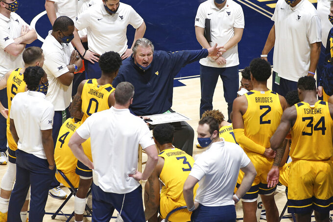 West Virginia coach Bob Huggins speaks with players during the second half of an NCAA college basketball game against Richmond Sunday, Dec. 13, 2020, in Morgantown, W.Va. (AP Photo/Kathleen Batten)