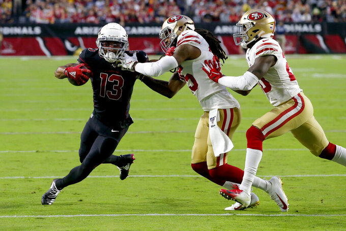 Arizona Cardinals wide receiver Christian Kirk (13) is tackled by San Francisco 49ers cornerback Richard Sherman (25) during the first half of an NFL football game, Thursday, Oct. 31, 2019, in Glendale, Ariz. (AP Photo/Rick Scuteri)