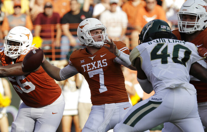 Texas quarterback Shane Buechele (7) throws against Baylor during the second half of an NCAA college football game, Saturday, Oct. 13, 2018, in Austin, Texas. (AP Photo/Eric Gay)