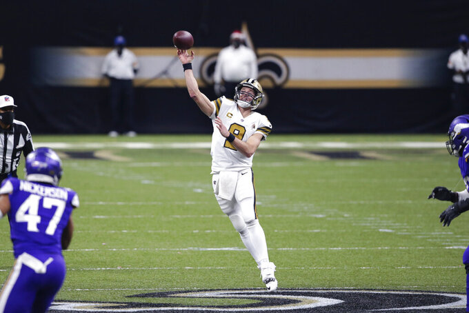 New Orleans Saints quarterback Drew Brees (9) passes in the second half of an NFL football game against the Minnesota Vikings in New Orleans, Friday, Dec. 25, 2020. During the game, Brees became the first NFL player to reach 8,000 yards passing . The Saints won 52-33. (AP Photo/Butch Dill)