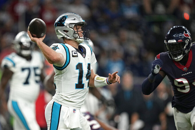 Carolina Panthers quarterback Sam Darnold (14) throws a pass against the Houston Texans during the first half of an NFL football game Thursday, Sept. 23, 2021, in Houston. (AP Photo/Eric Christian Smith)