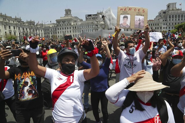 People celebrate after the resignation of interim president Manuel Merino, at Plaza San Martin in Lima, Peru, Sunday, Nov. 15, 2020. Merino resigned after a violent crackdown on protests that left at least two people dead followed by an exodus of his cabinet members. (AP Photo/Martin Mejia)
