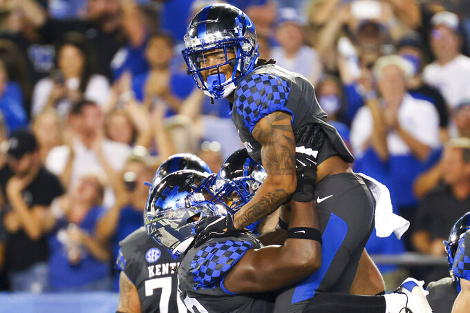 Kentucky wide receiver Wan'Dale Robinson (1) celebrates his touchdown during the first half of an NCAA college football game against LSU in Lexington, Ky., Saturday, Oct. 9, 2021. (AP Photo/Michael Clubb)
