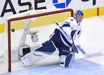Tampa Bay Lightning goaltender Andrei Vasilevskiy (88) makes a save against the Florida Panthers during the third period of an exhibition NHL hockey game ahead of the Stanley Cup playoffs in Toronto on Wednesday, July 29, 2020.  (Nathan Denette/The Canadian Press via AP)