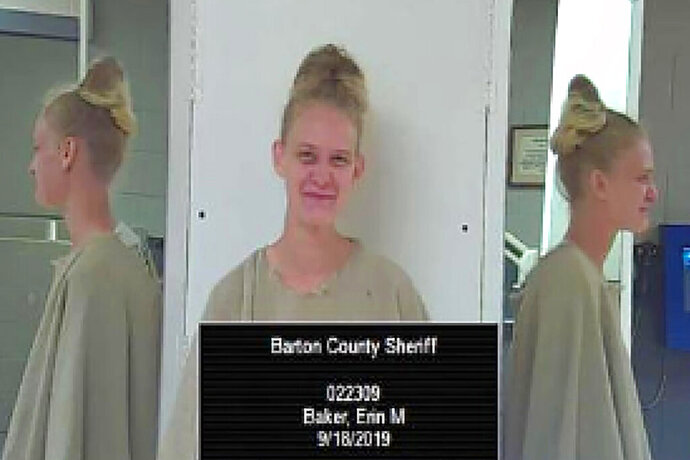 This Wednesday, Sept. 18, 2019 photo provided by the Barton County Sheriff's Office in Great Bend, Kan., shows Erin Baker. Baker is the girlfriend of David Madden, who wounded two Kansas law enforcements officers, killed his father and then killed himself this spring. The Kansas Bureau of Investigation announced Thursday Sept. 19 that Baker was arrested Wednesday on suspicion of interference with a law enforcement officer, aggravated child endangerment and obstruction of apprehension. (Barton County Sheriff's Office via AP)