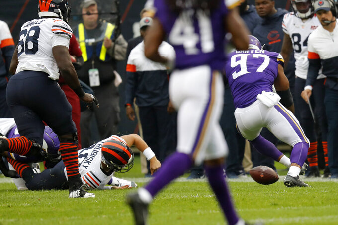 Chicago Bears quarterback Mitchell Trubisky, left, is injured as he fumbles toward Minnesota Vikings defensive end Everson Griffen (97) during the half of an NFL football game Sunday, Sept. 29, 2019, in Chicago. (AP Photo/Charles Rex Arbogast)