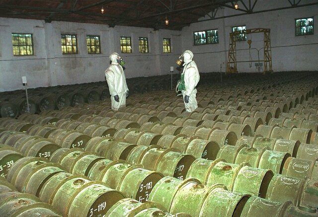 FILE - In this Saturday, May 20, 2000 file photo, two Russian soldiers make a routine check of metal containers with toxic agents at a chemical weapons storage site in the town of Gorny, 124 miles (200 kms) south of the Volga River city of Saratov, Russia. Novichok, a deadly nerve agent that has left Russian opposition politician Alexei Navalny in a coma and nearly killed a former Russian spy and his daughter in 2018, was the product of a highly secretive Soviet chemical weapons program. Just a few milligrams of the odorless liquid — the weight of a snowflake — are enough to kill a person within minutes.  (AP Photo, File)