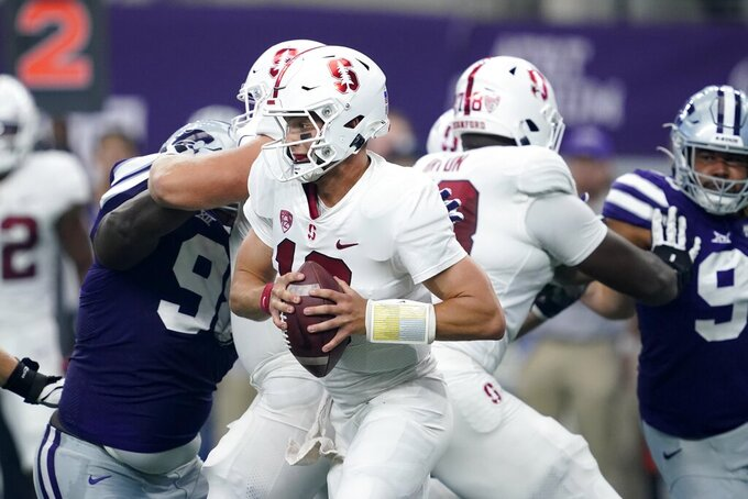 Stanford quarterback Jack West (10) scrambles out of the pocket under pressure from Kansas State in the first half of an NCAA college football game in Arlington, Texas, Saturday, Sept. 4, 2021. (AP Photo/Tony Gutierrez)