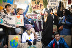 Swedish climate activist Greta Thunberg, center, is pictured during a