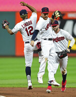 Cleveland Indians' Jordan Luplow, right, and Francisco Lindor celebrate after the Indians defeated the Detroit Tigers 8-0 in a baseball game Tuesday, July 16, 2019, in Cleveland. (AP Photo/David Dermer)