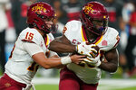 Iowa State quarterback Brock Purdy (15) hands the ball off to running back Breece Hall (28) during the first half of an NCAA college football game against the UNLV, Saturday, Sept. 18, 2021, in Las Vegas. (AP Photo/John Locher)