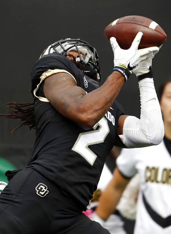 FILE - In this Saturday, Oct. 6, 2018, file photo, Colorado wide receiver Laviska Shenault Jr. pulls in a pass for a touchdown against Arizona State in the second half of an NCAA college football game in Boulder, Colo. Shenault is the nation's leading receiver and plays for an undefeated Power Five team, yet he remains something of an afterthought in a Heisman conversation that has been dominated by quarterbacks such as Alabama's Tua Tagovailoa and Ohio State's Dwayne Haskins thus far.  AP Photo/David Zalubowski, File)