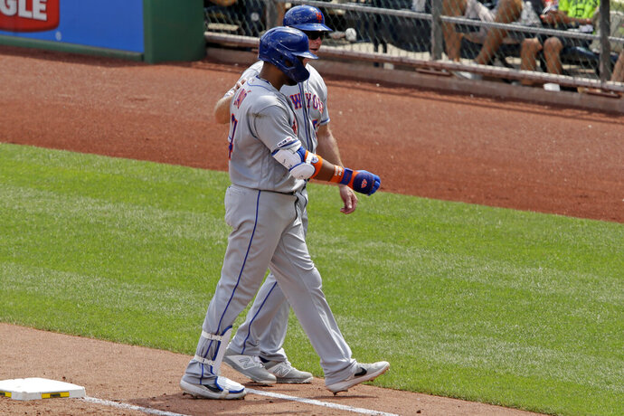 New York Mets' Robinson Cano, front, is helped off the field by first base coach Glenn Sherlock, back, during the fourth inning of a baseball game against the Pittsburgh Pirates in Pittsburgh, Sunday, Aug. 4, 2019. (AP Photo/Gene J. Puskar)