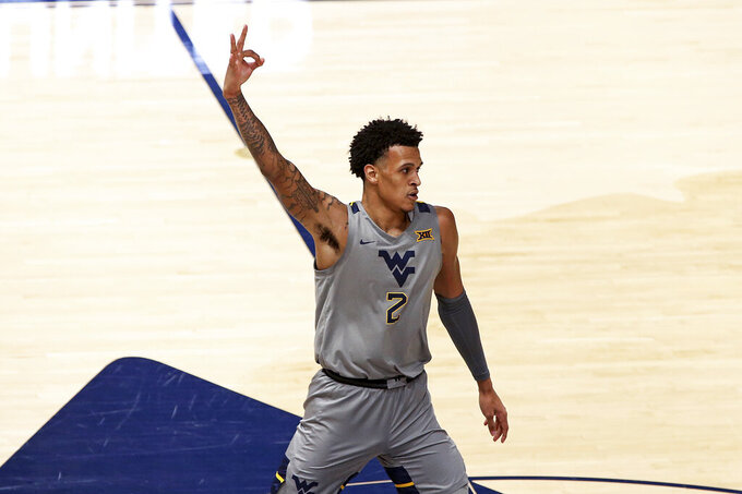 West Virginia forward Jalen Bridges (2) reacts after scoring against Kansas during the first half of an NCAA college basketball game Saturday, Feb. 6, 2021, in Morgantown, W.Va. (AP Photo/Kathleen Batten)
