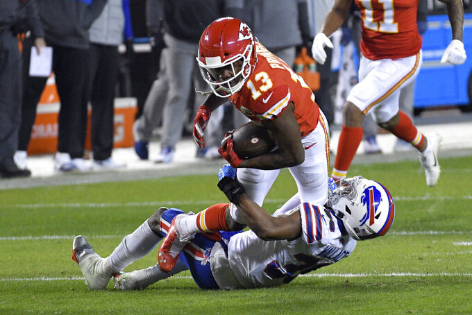 Kansas City Chiefs wide receiver Byron Pringle (13) is tackled by Buffalo Bills cornerback Levi Wallace after catching a pass during the first half of the AFC championship NFL football game, Sunday, Jan. 24, 2021, in Kansas City, Mo. (AP Photo/Reed Hoffmann)