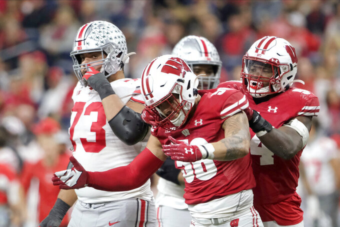 Wisconsin linebacker Zack Baun (56) celebrates after sacking Ohio State quarterback Justin Fields during the first half of the Big Ten championship NCAA college football game Saturday, Dec. 7, 2019, in Indianapolis. (AP Photo/AJ Mast)