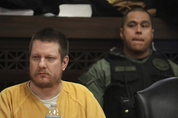 FILE - In this Jan. 18, 2019 file photo, former Chicago police Officer Jason Van Dyke attends his sentencing hearing at the Leighton Criminal Court Building in Chicago, for the 2014 shooting of Laquan McDonald. The wife of the white Chicago police officer who fatally shot the black teenager McDonald said on Wednesday, Feb. 13, 2019, that her husband has been assaulted by inmates in his cell at a Connecticut prison. The Chicago Sun-Times reports that Tiffany Van Dyke says Jason Van Dyke had been placed in the prison's general population before being assaulted. (Antonio Perez/Chicago Tribune via AP, Pool, File)