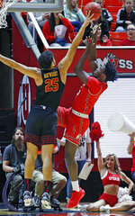 Utah forward Donnie Tillman, right, goes to the basket as Southern California forward Bennie Boatwright (25) defends in the first half during an NCAA college basketball game Thursday, March 7, 2019, in Salt Lake City. (AP Photo/Rick Bowmer)