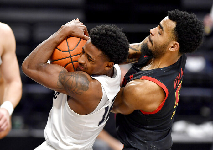 Penn State's Izaiah Brockington and Maryland's Eric Ayala, right, tussle for the ball in the final minutes of an NCAA college basketball game Friday, Feb. 5, 2021, in State College, Pa. (Abby Drey/Centre Daily Times via AP)