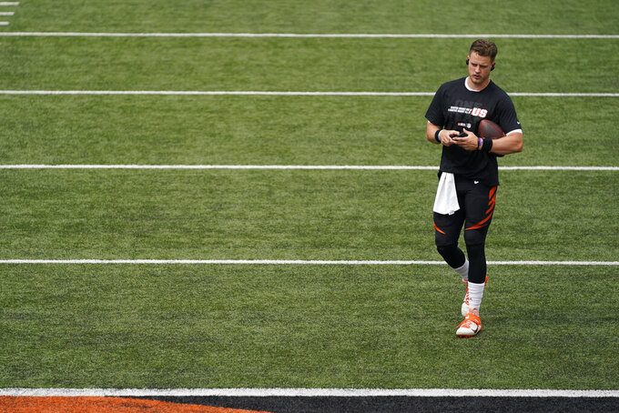 Cincinnati Bengals quarterback Joe Burrow warms up before an NFL football game against the Los Angeles Chargers, Sunday, Sept. 13, 2020, in Cincinnati. (AP Photo/Bryan Woolston)