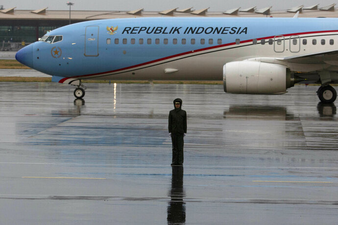 A plane with Indonesian Vice President Jusuf Kalla taxies onto the special plane terminal of the Beijing International airport ahead of the Belt and Road Forum held in Beijing on Wednesday, April 24, 2019. (AP Photo/Ng Han Guan, Pool)