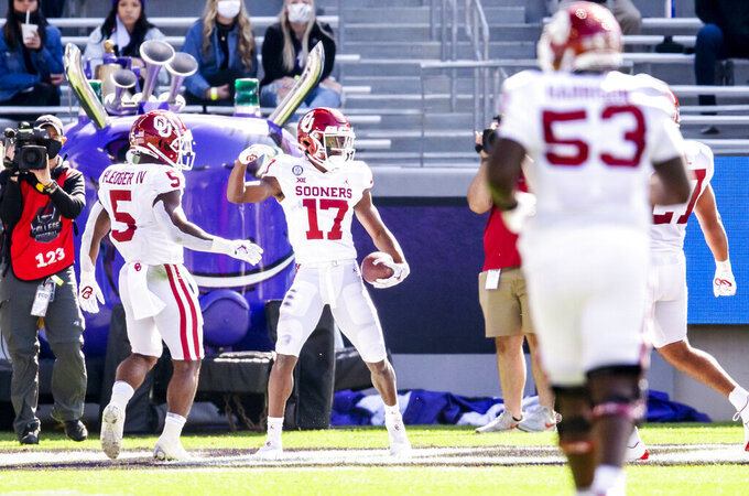 Oklahoma Sooners wide receiver Marvin Mims (17) celebrates scoring a touchdown during the first half of an NCAA College football game against TCU, Saturday, Oct. 24, 2020, in Fort Worth, Texas. (AP Photo/Brandon Wade)