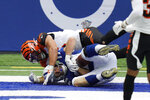 Indianapolis Colts' Jack Doyle, bottom, makes a touchdown reception against Cincinnati Bengals' Logan Wilson, top, during the second half of an NFL football game, Sunday, Oct. 18, 2020, in Indianapolis. (AP Photo/AJ Mast)