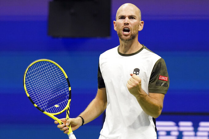 Adrian Mannarino, of France, celebrates after winning a set in a tiebreaker against Stefanos Tsitsipas, of Greece, during the second round of the US Open tennis championships, Wednesday, Sept. 1, 2021, in New York. (AP Photo/Frank Franklin II)