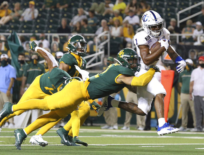 Kansas running back Pooka Williams Jr. (1) scores a touch \down past Baylor linebacker Terrel Bernard (2) during the second half of an NCAA college football game in Waco, Texas, Saturday, Sept. 26, 2020. (Jerry Larson/Waco Tribune-Herald via AP)