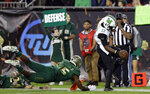 Marshall quarterback Isaiah Green (17) eludes South Florida defensive end Vincent Jackson Jr., (15) on an 11-yard touchdown run during the first half of the Gasparilla Bowl NCAA college football game Thursday, Dec. 20, 2018, in Tampa, Fla. (AP Photo/Chris O'Meara)