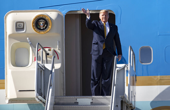 President Donald Trump acknowledges awaiting supporters as he departs Air Force One after arriving at Los Angeles International Airport on Tuesday, Sept. 17, 2019 in Los Angeles. (Gina Ferazzi/Los Angeles Times via AP)
