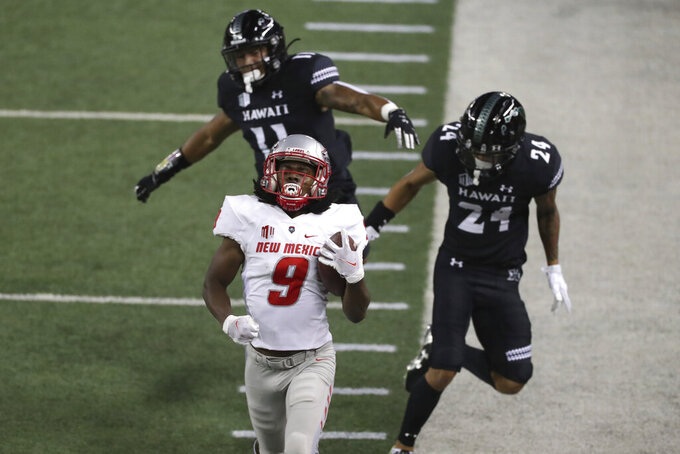 Hawaii defensive back Sterlin Ortiz (11) and defensive back Kai Kaneshiro (24) can't stop New Mexico wide receiver Jordan Kress (9) from reaching the end zone for a touchdown during the first quarter of an NCAA college football game Saturday, Nov. 7, 2020, in Honolulu. (AP Photo/Marco Garcia)